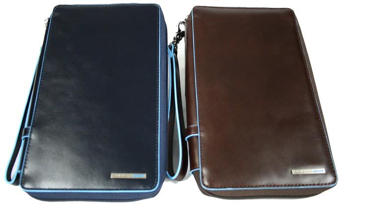 Bolso de mano hombre en azul o marrón, de la marca Piquadro