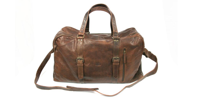 Bolsa de viaje en piel envejecida con herrajes en color bronce - comprar online precio 239€ euros