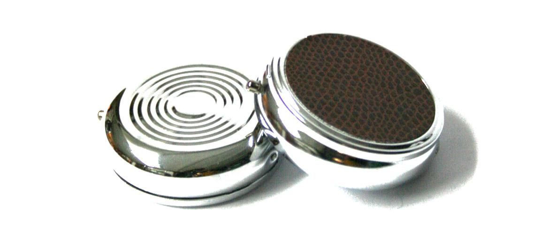 Pastillero de bolsillo de metal y efecto piel redondo - comprar online precio 16€ euros